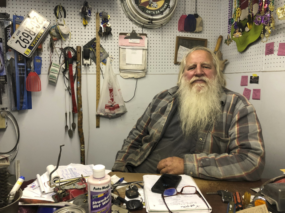 Danny Rice, 67, discusses the coronavirus in his auto repair shop in downtown Elmwood, Neb., on Monday. Rice has continued his life as normal during the pandemic, even though he recognizes that the virus is potentially dangerous for high-risk people, including him.