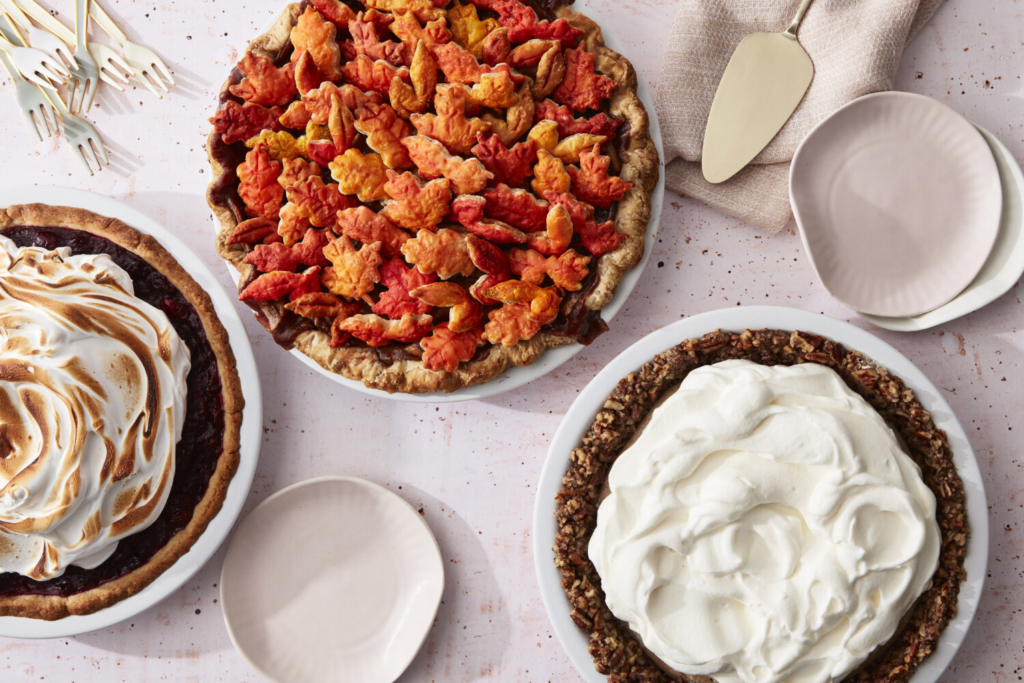 From left: Roasted Cranberry with Meringue topping in Press in Cookie Crust; Caramel Apple Pie with an All-Butter Crust and Painted Cutout Topping; Fall-Spice Pudding Pie with Whipped Cream and a Nut Crust.