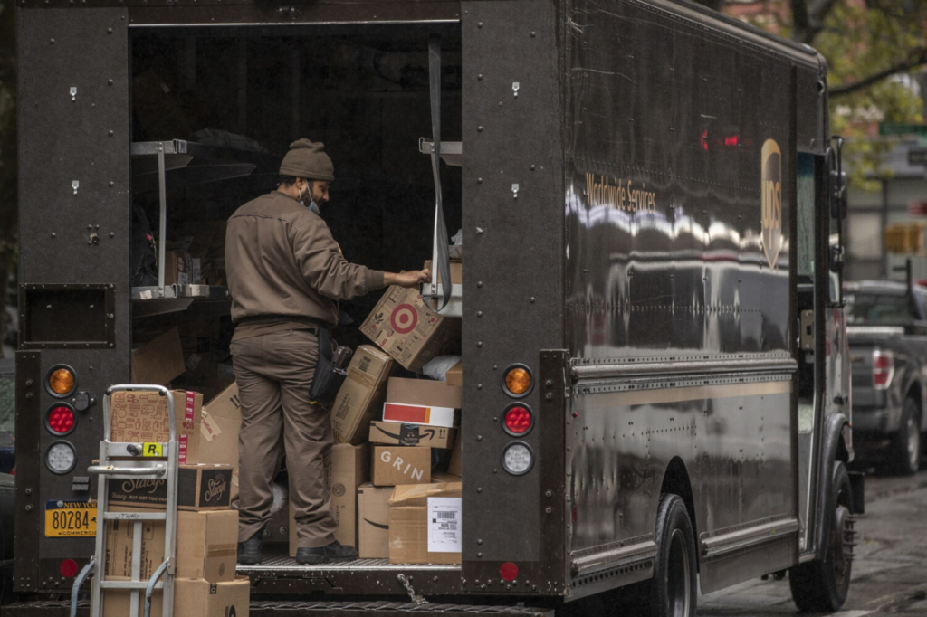 A United Parcel Service Inc. driver sorts boxes in New York on Oct. 13.