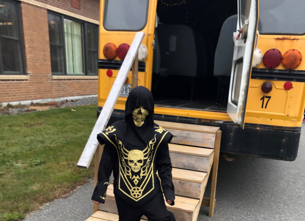 An unidentified Carrabec Community School students made is way through the haunted school bus.
