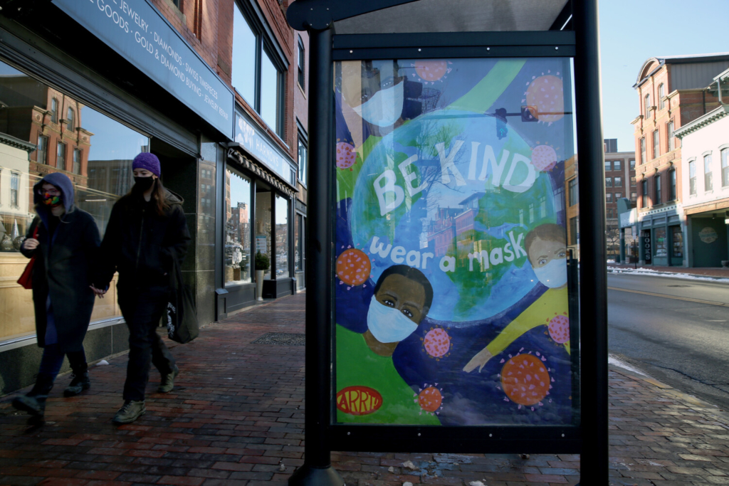 A poster on a bus stop on Congress Street advises the use of face coverings on Dec. 10.