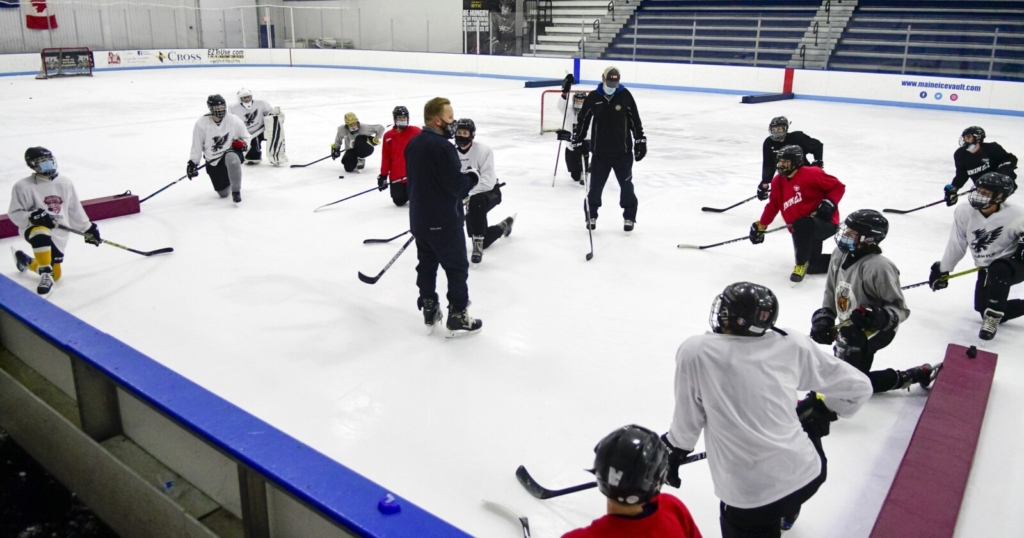 Capital Region Hawks head coach Richard Fortin talks to players during a skills and drills session Dec. 8 at the Ice Vault in Hallowell.