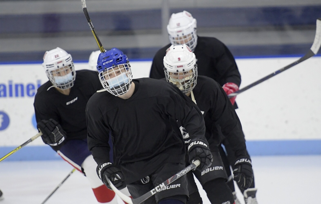 Cony hockey players skate during practice  Wednesday at the Ice Vault in Hallowell.