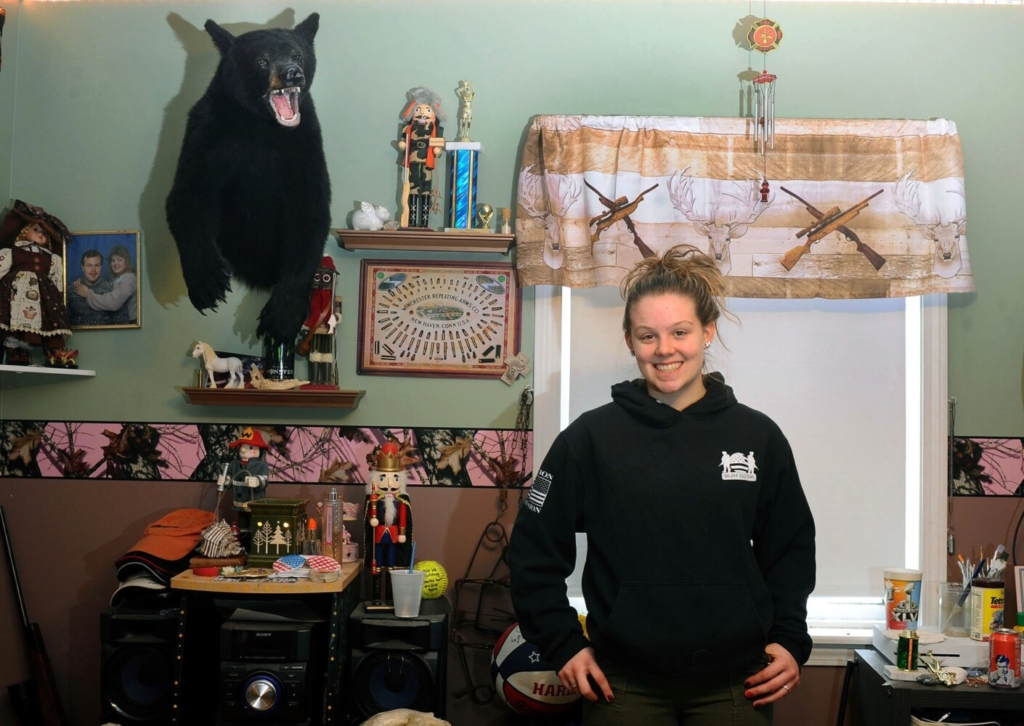 """Cassidy Rood, 16, at her Benton home Sunday. She is already an accomplished hunter who recently completed the """"grand slam"""" of big game hunting by bagging a turkey, bear, deer and moose in one year."""