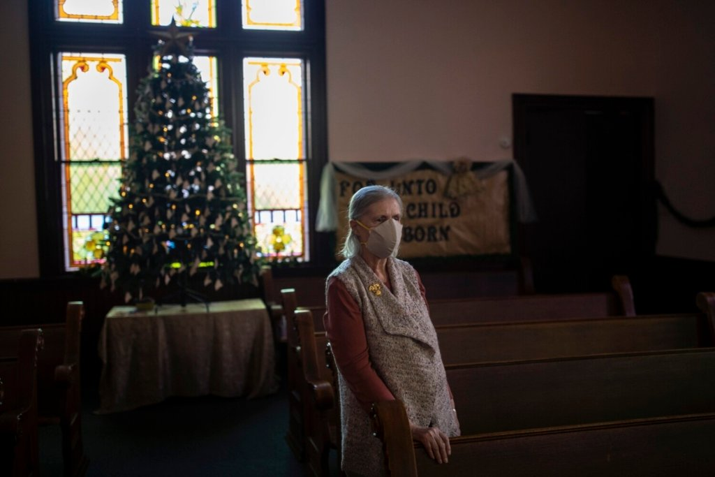 Marilyn Davis at Bowdoinham Nazarene Church with the Memory Tree on Wednesday. Davis came up with the idea for a Christmas tree with ornaments honoring all of the Mainers who have died from COVID-19.