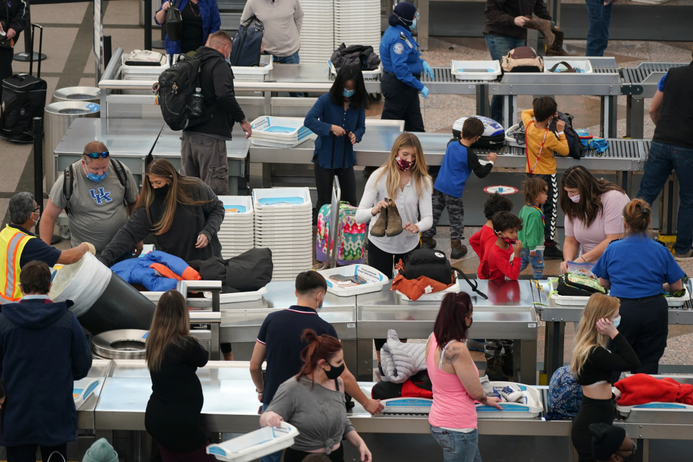 Travelers pass through the south security checkpoint in the main terminal of Denver International Airport on Tuesday in Denver.