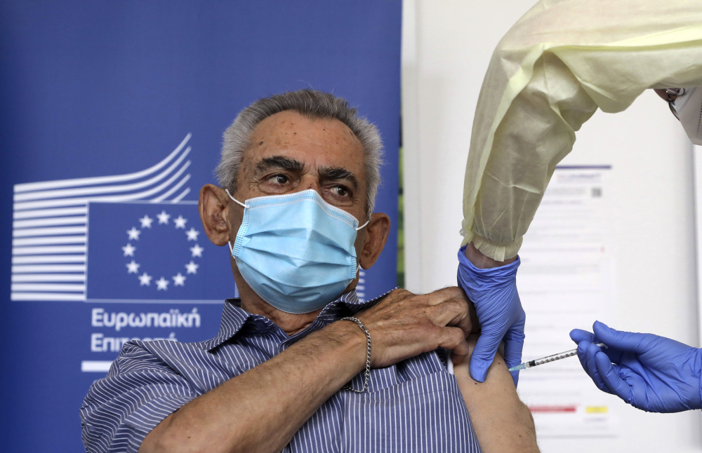 Andreas Raounas, 84, was the first patient at a care home in Nicosia, Cyprus, on Sunday to get the vaccine.