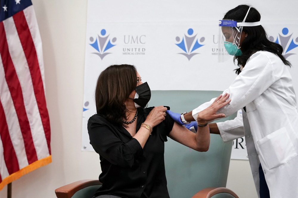 Vice President-elect Kamala Harris thanks nurse Patricia Cummings after she received the Moderna COVID-19 vaccine from Cummings, Tuesday Dec. 29, at United Medical Center in southeast Washington.