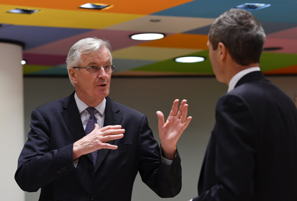 European Union's chief Brexit negotiator, Michel Barnier, left, speaks with Ambassador Michael Clauss, Permanent Representative of Germany to the European Union, during a meeting of EU ambassadors in Brussels on Tuesday. Problems increased Monday in the bid to put a trade deal between the European Union and the United Kingdom before a Brexit transition period ends on New Year's Day, with the EU legislature insisting it will not have time to approve a deal. (John Thys, Pool via AP)