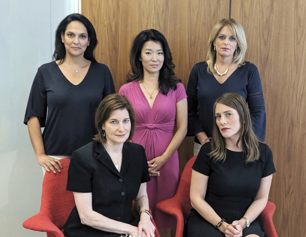 This undated photo provided by Wigdor Law in December shows anchorwomen from the NY1 news channel in New York. In the back row from left are Jeanine Ramirez, Vivian Lee and Kristen Shaughnessy. In the front row are Roma Torre, left, and Amanda Farinacci.