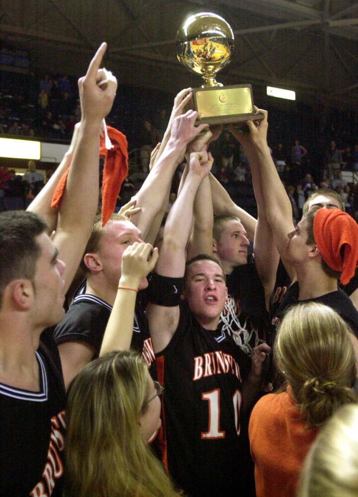The Brunswick boys basketball team took home the gold ball  after defeating Deering in the Class A state championship game March 16, 2002 at the Cumberland County Civic Center in Portland.