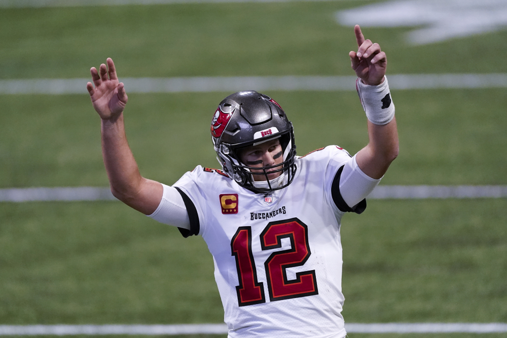 Tampa Bay quarterback Tom Brady reacts after a Buccaneers touchdown against the Falcons during the second half on Sunday in Atlanta.