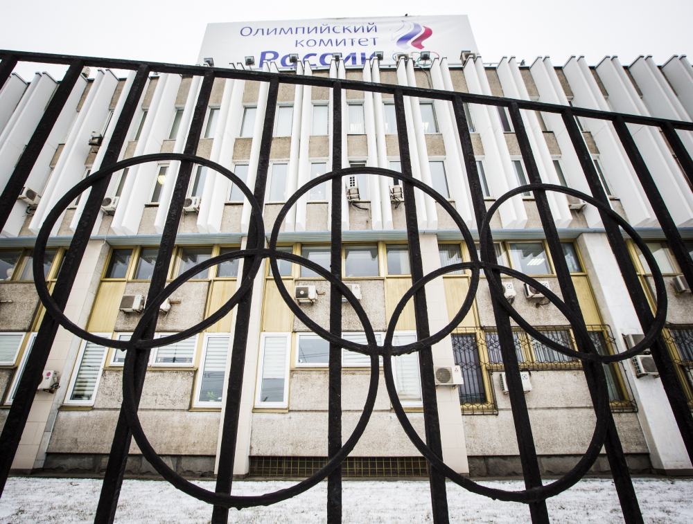 The building of the Russian Olympic Committee is seen through a gate decorated with the Olympic rings, in Moscow, Russia in 2017.