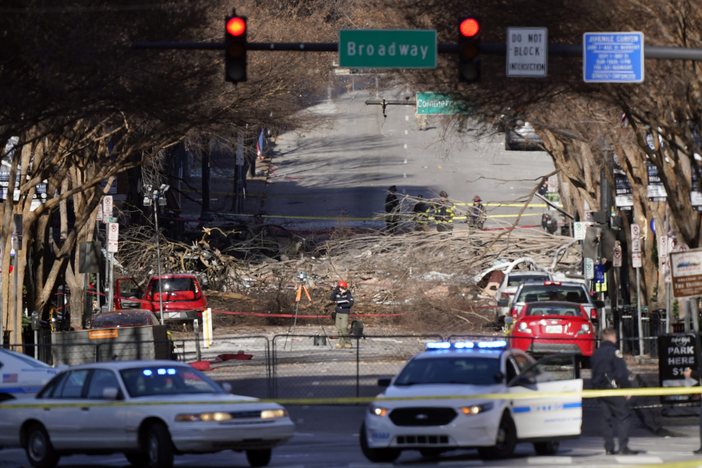Investigators continue to examine the site of an explosion Sunday, Dec. 27, in downtown Nashville, Tenn.