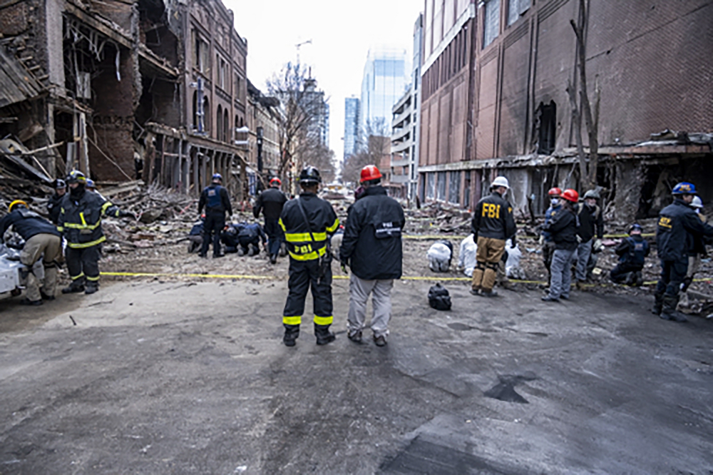 In this photo provided by the FBI and Bureau of Alcohol, Tobacco, Firearms and Explosives, FBI and ATF Evidence Response Teams process the scene, Monday, Dec. 28, of the Christmas Day blast in Nashville, Tenn.