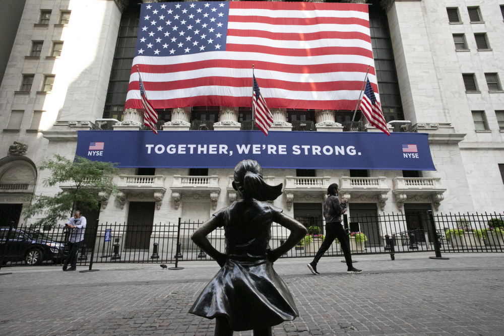The Fearless Girl statue stands in front of the New York Stock Exchange.