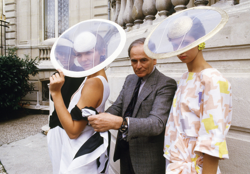 Paris couturier Pierre Cardin and models wearing ensembles from the summer 1985 ready-to-wear Cardin collection pose in Paris, in summer 1984.