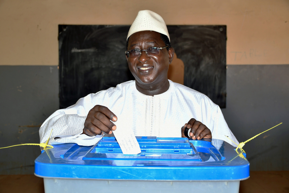Then opposition presidential candidate Soumaila Cissé casting his ballot during the presidential second round election in Niafunke, Mali, in August 2018. Cissé has died in Paris, his family said Friday. (Boubacar Sada Sissoko/Union for the Republic and Democracy via AP, File)