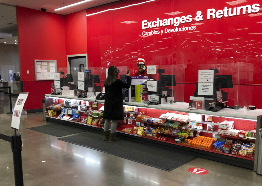 A customer is shown at the exchanges and return counter in a Target department store early Wednesday in Glendale, Colo.