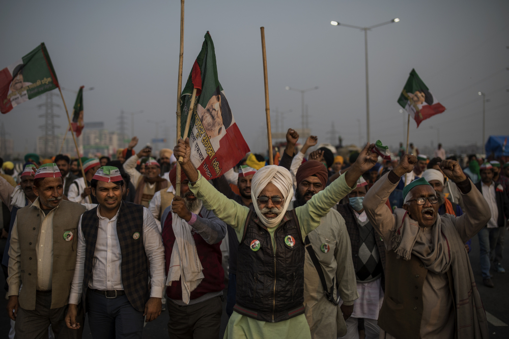 Indian farmers block a major highway during a protest against new farm laws at the Delhi-Uttar Pradesh state border on Dec. 5.