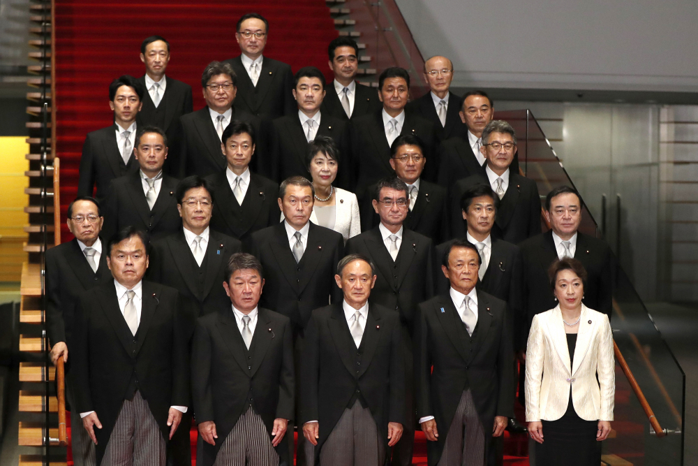 Japan's Prime Minister Yoshihide Suga, front center, and his Cabinet in September at his official residence in Tokyo.
