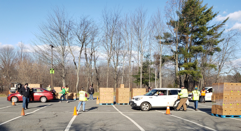 Kennebec Valley Community College students, faculty and staff and Kennebec Valley Community Action Program  employees hand out boxes of farm-grown produce on Nov. 21 to families. The event was held in the parking lot of the Fairfield college.