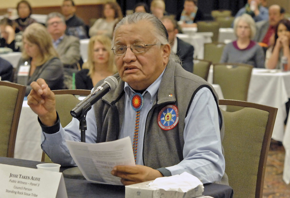 """Jesse Taken Alive,  former chairman of the Standing Rock Sioux Tribe testifying in 2013.   Family members say """"Jay"""" Taken Alive died in December after contracting COVID-19, not long after his wife passed away from the coronavirus."""