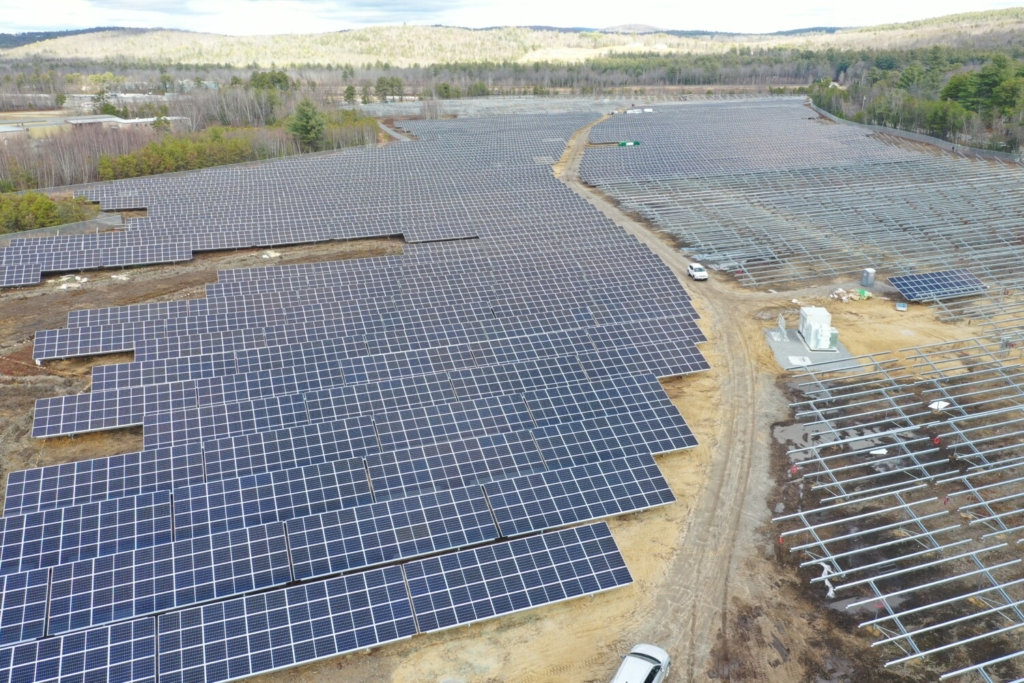 Workers are installing 30,000 solar-electric panels at the BNRG/Dirigo solar farm off Route 26 in Oxford, part of an unprecedented wave of large-scale solar projects being developed in Maine. The 38-acre site, adjacent to Oxford Plains Speedway, had been zoned for a business park.