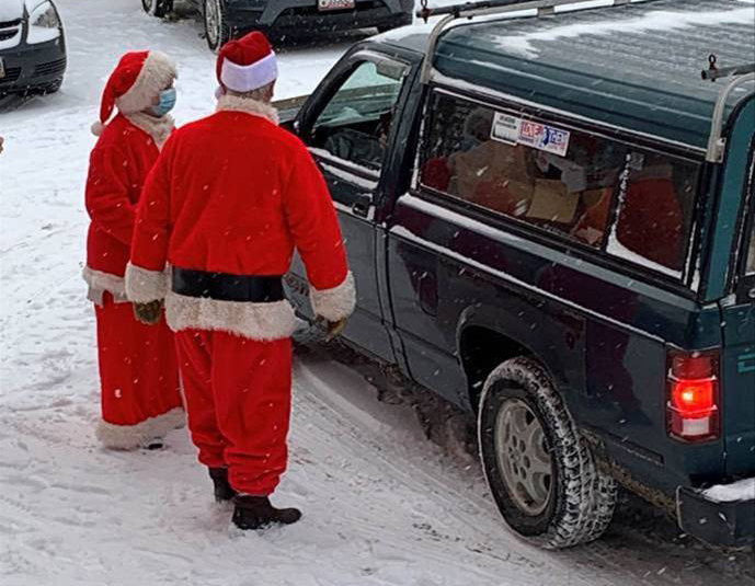"""""""Tom Ross was Santa and Mrs. Claus, Shirley Melancon, was Santa, Tom Ross, deliver meals Dec. 22 during the weekly drive-thru meals program at St. Anthony's Soup Kitchen in Skowhegan."""