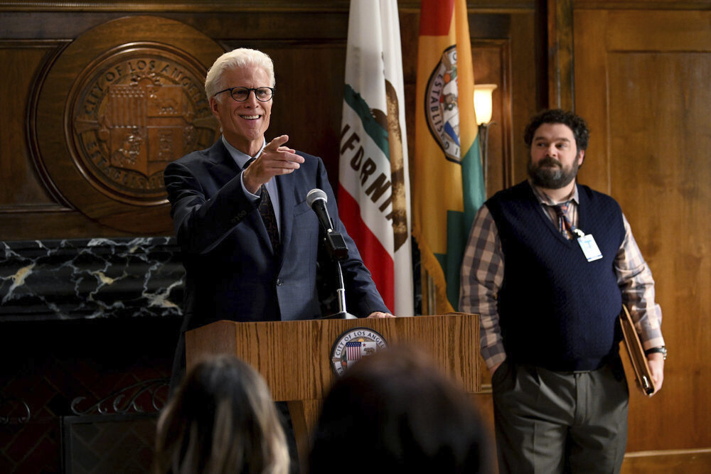 """Ted Danson as Mayor Neil Bremer, left, and Bobby Moynihan as Jayden Kwapis in a scene from the new comedy """"Mr. Mayor."""" premiering on Thursday.  (Mitchell Haddad/NBC via AP)"""