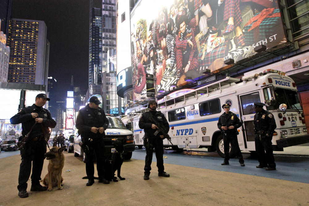 Heavily armed police officers stand guard during the New Year's Eve celebration in New York's Times Square in 2011. Although New York City police have turned to familiar tactics ahead of the iconic Thursday, Dec. 31, 2020, ball drop, the department's playbook this year includes an unusual mandate: preventing crowds from gathering in Times Square.
