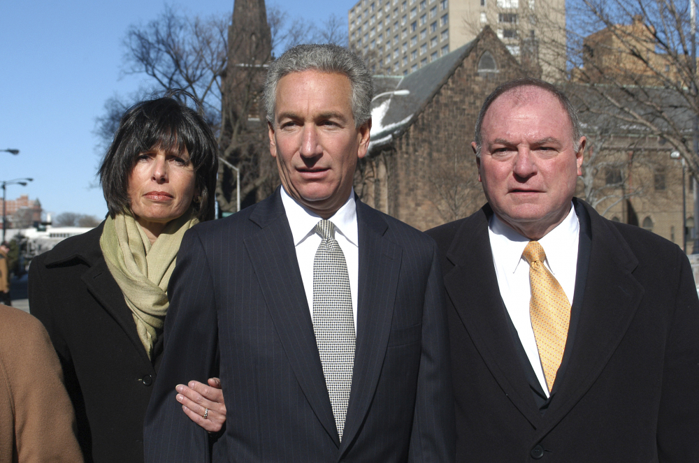 Charles B. Kushner, flanked by his wife, Seryl Beth, and his attorney Alfred DeCotiis arrives at the Newark Federal Court for sentencing in Newark, N.J., in 2005. President Trump on Wednesday pardoned Kushner, the father of his son-in-law. Charles Kushner had pleaded guilty to tax evasion and making illegal campaign contributions.