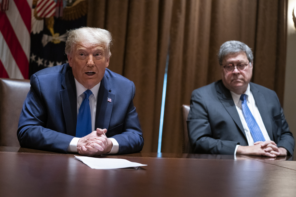 Attorney General William Barr listens as President Trump speaks during a meeting with Republican state attorneys general in September.