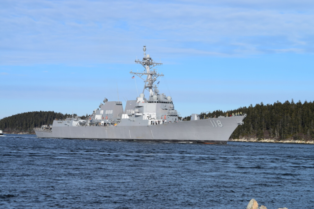 The USS Daniel Inouye coasted down the Kennebec River this month on its way to at-sea trials. The defense policy bill vetoed by President Trump on Wednesday approves two new Arleigh Burke-class destroyers, one of which will be built at Bath Iron Works.