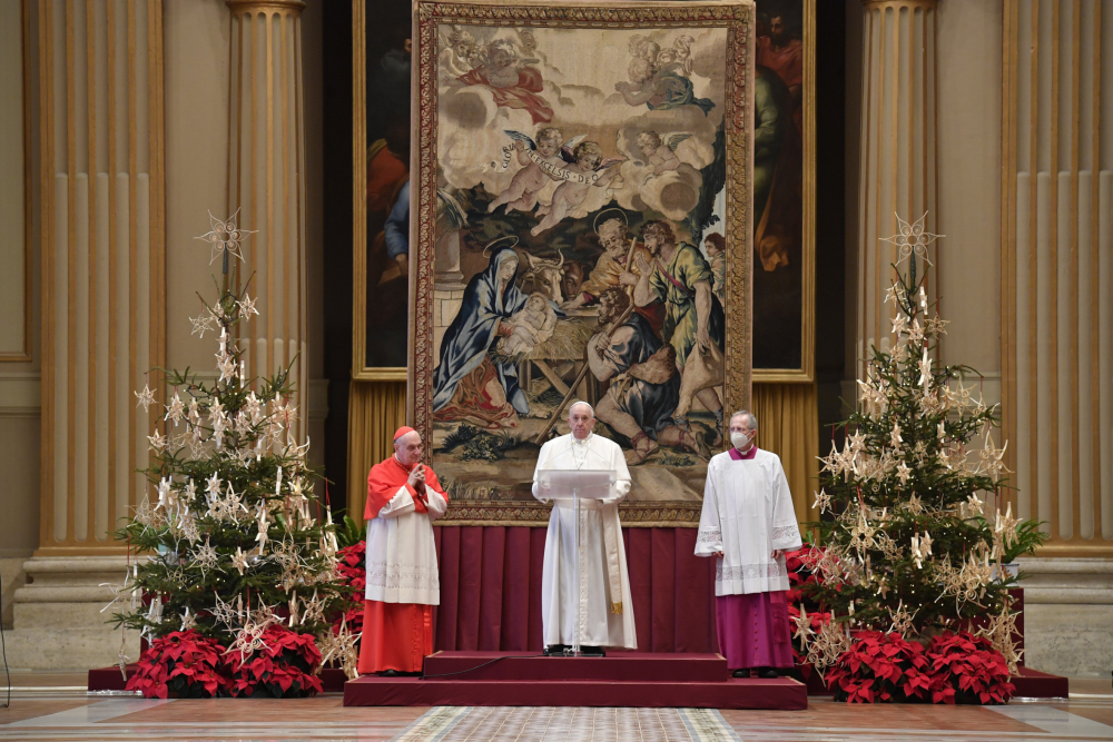 """Pope Francis delivers the """"Urbi et Orbi"""" Christmas blessing inside the hall of St. Peter's Basilica, at the Vatican, on Friday."""
