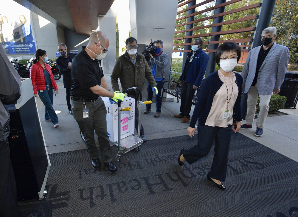Doses of the Pfizer BioNTech COVID-19 vaccine arrive at Providence St. Joseph Hospital in Orange, Calif. on Wednesday, Dec. 16.