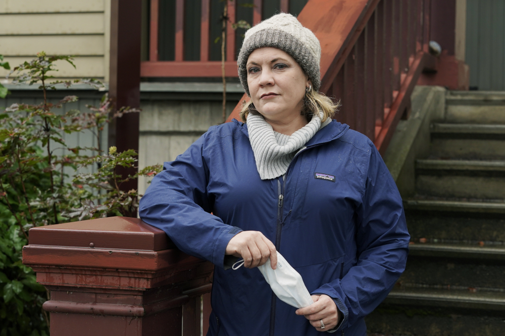 Angela Rasmussen, a Seattle-based virus researcher affiliated with Georgetown University in Washington, D.C., poses for a photo, Wednesday, Dec. 30, at a school near her home in Seattle. In another time, experts like Rasmussen would have enjoyed the esteem, respect and relative obscurity afforded by academia. But for better or worse, COVID-19 has thrust virologists, epidemiologists and other normally low-profile scientists into the pop culture crucible this year.