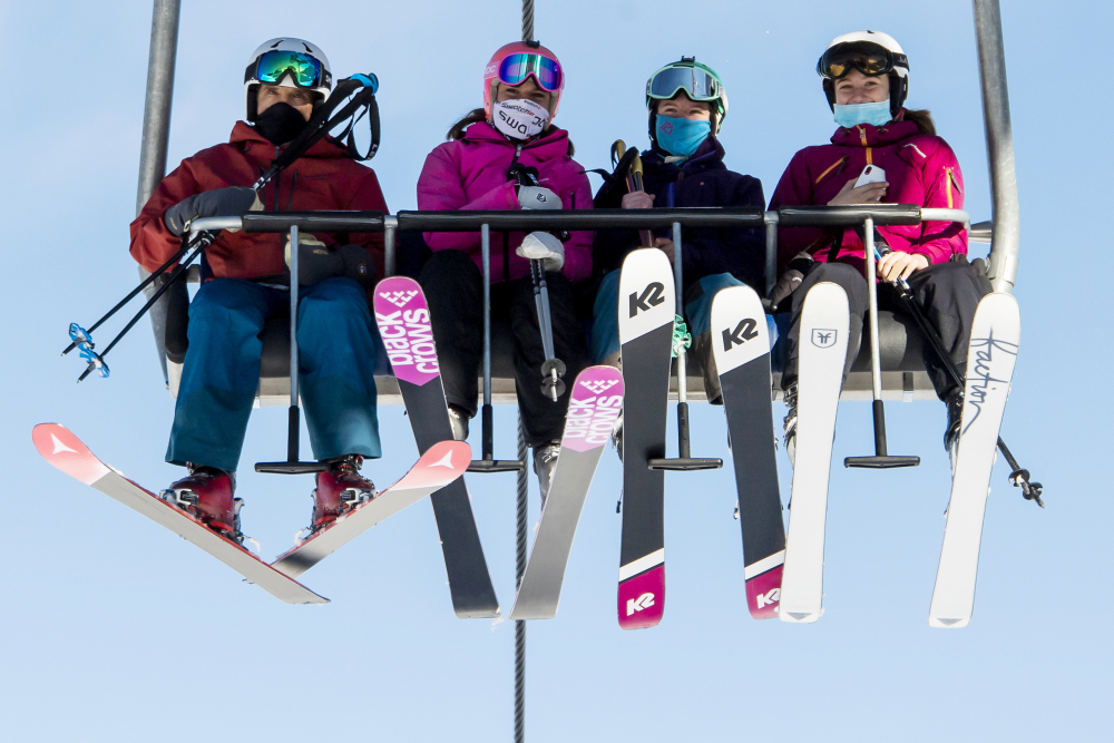 Skiers ride a chairlift on Oct. 30, the opening day of the Verbier ski area in the Swiss Alps.