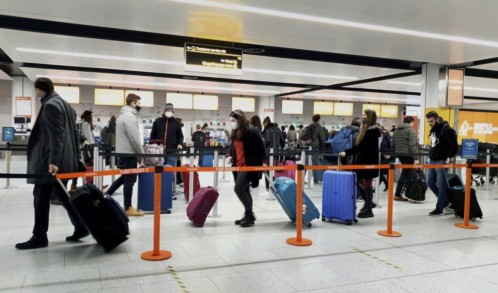 Passengers queue for check-in at Gatwick Airport Dec. 20 in West Sussex, England, south of London.