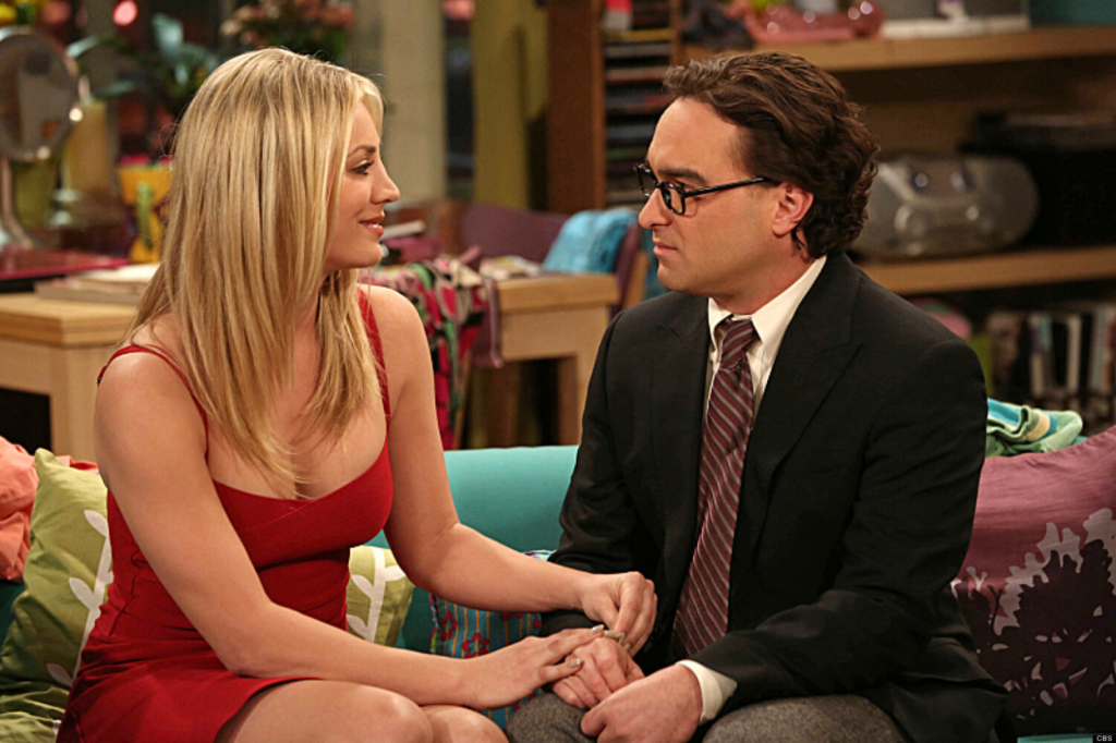 """""""The Tangible Affection Proof"""" While the guys try to give their significant others the perfect Valentine's Day, Raj and Stuart throw a lonely people party at the comic book store, on """"The Big Bang Theory. Left: Penny (Kaley Cuoco), Right: Leonard (Johnny Galecki)."""