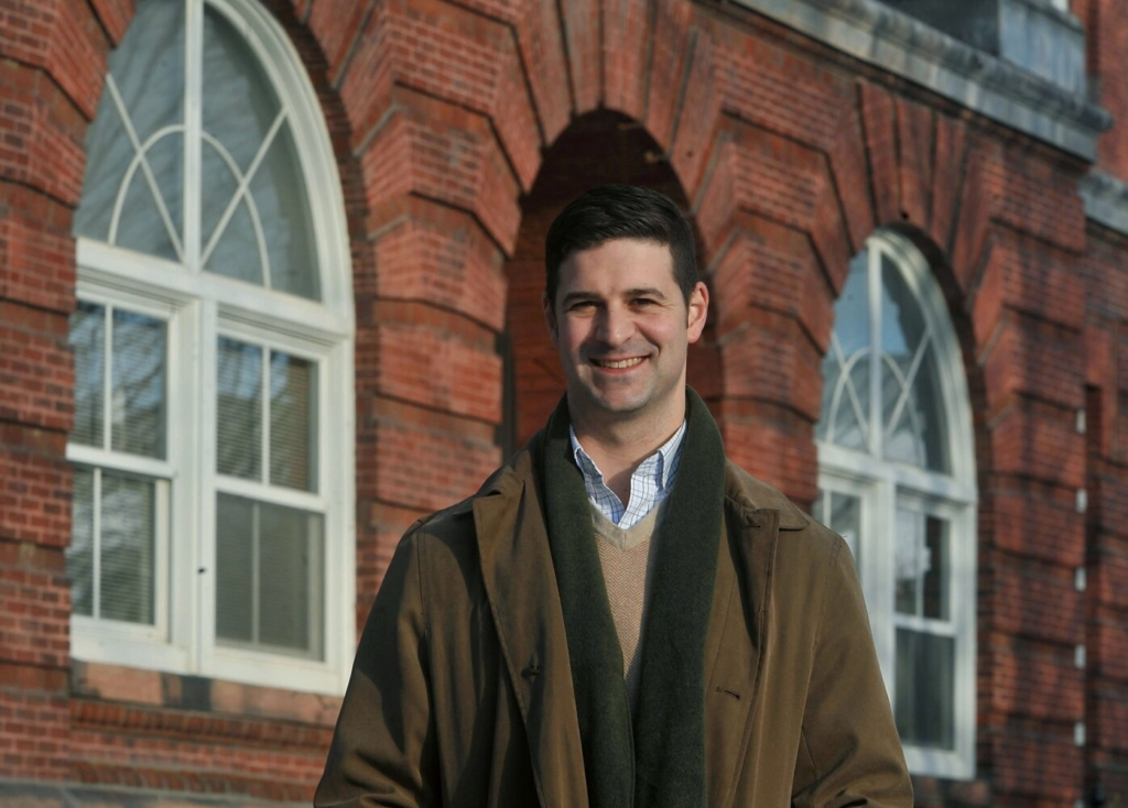 Nick Isgro served as the mayor of Waterville for six years, He is shown outside Waterville City Hall on Tuesday.