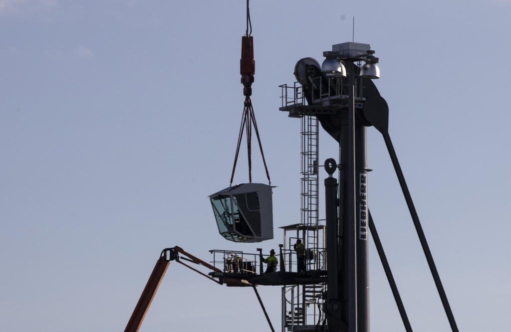 The cab of the new Liebherr mobile harbor crane is lifted into place by the International Marine Terminal's other crane at on Tuesday in Portland. The additional crane is the final step in a multimillion-dollar improvement project.