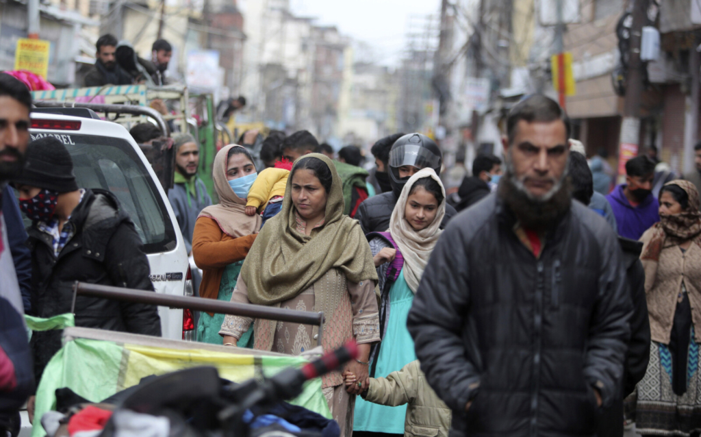Indians crowd a Sunday market in Jammu, India, on Sunday. India authorized two COVID-19 vaccines on Sunday, paving the way for a huge inoculation program to stem the pandemic in the world's second most populous country.