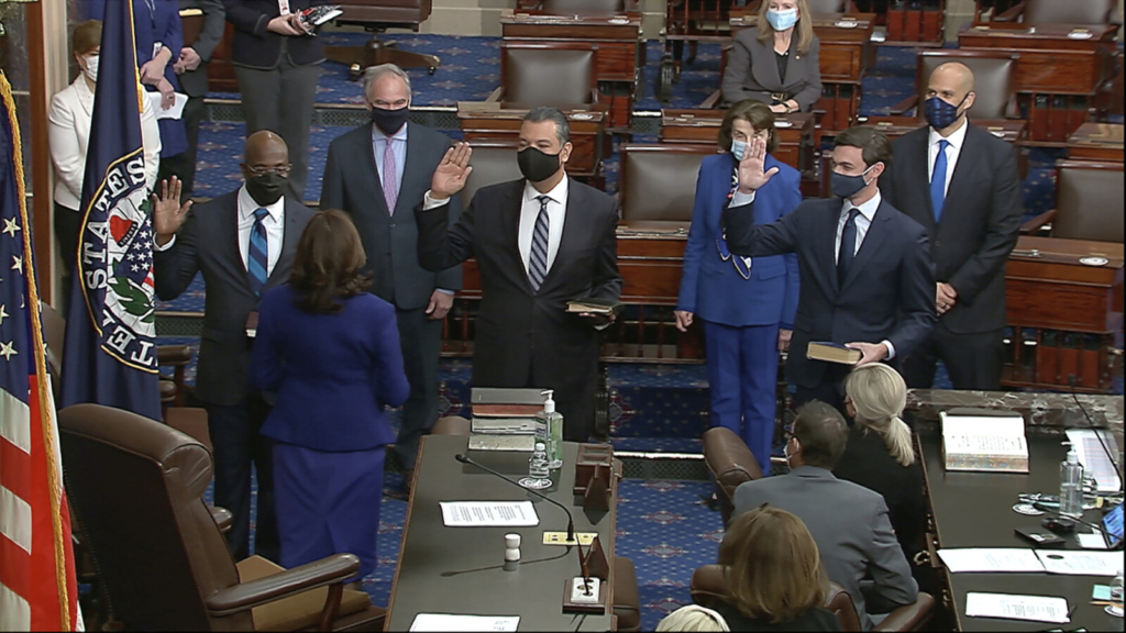 In this image from video, Vice President Kamala Harris swears in Sen. Raphael Warnock, D-Ga., Sen. Alex Padilla, D-Calif., and Sen. Jon Ossoff, D-Ga., on the floor of the Senate on Wednesday on Capitol Hill in Washington.
