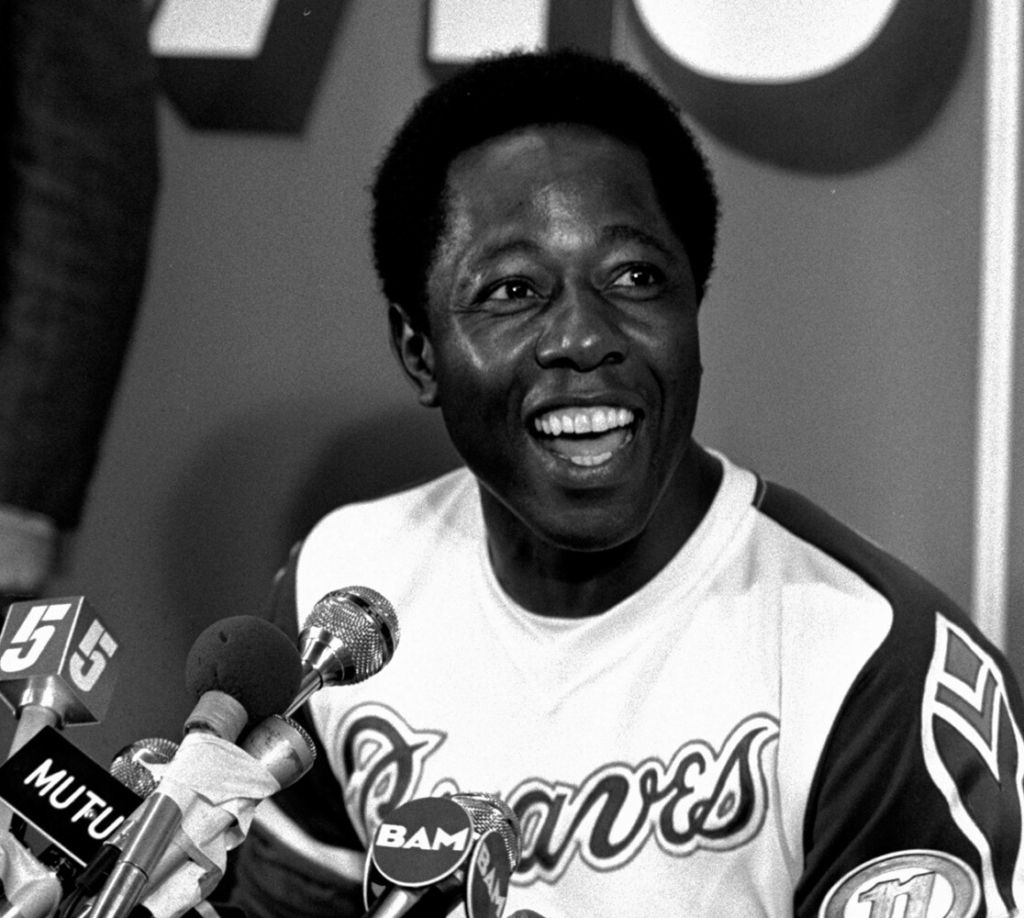 Atlanta Braves' Hank Aaron smiles during a press conference following a baseball game against the Los Angeles Dodgers where Aaron hit his 715th career home run in Atlanta, Monday, April 8, 1974. Aaron, who endured racist threats with stoic dignity during his pursuit of Babe Ruth but went on to break the career home run record in the pre-steroids era, died early Friday, Jan. 22, 2021. He was 86.