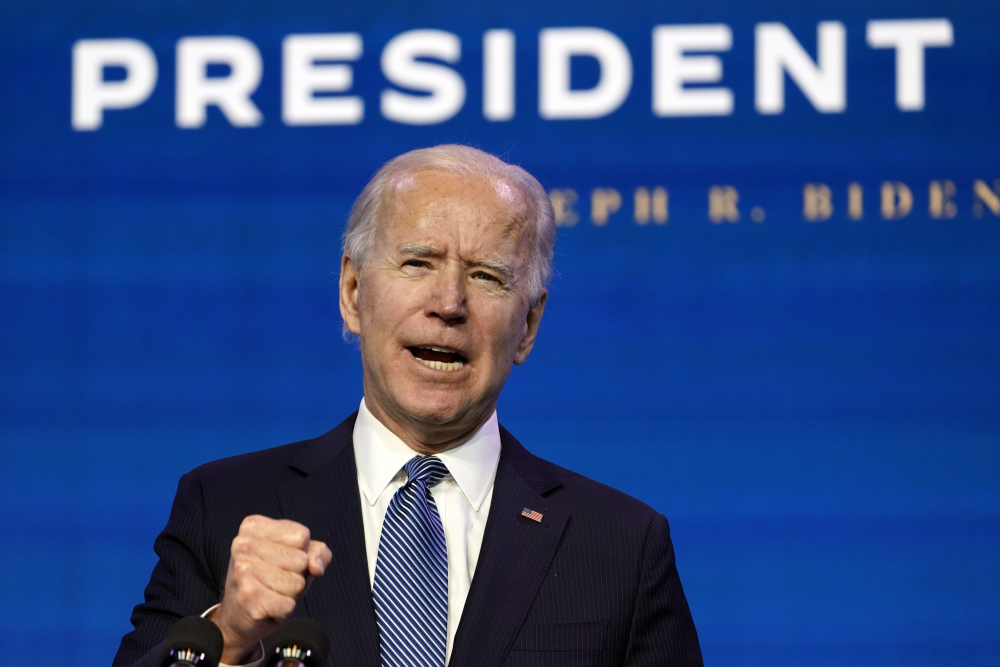 President-elect Joe Biden speaks during an event at The Queen theater in Wilmington, Del., Thursday, Jan. 7, to announce key nominees for the Justice Department.