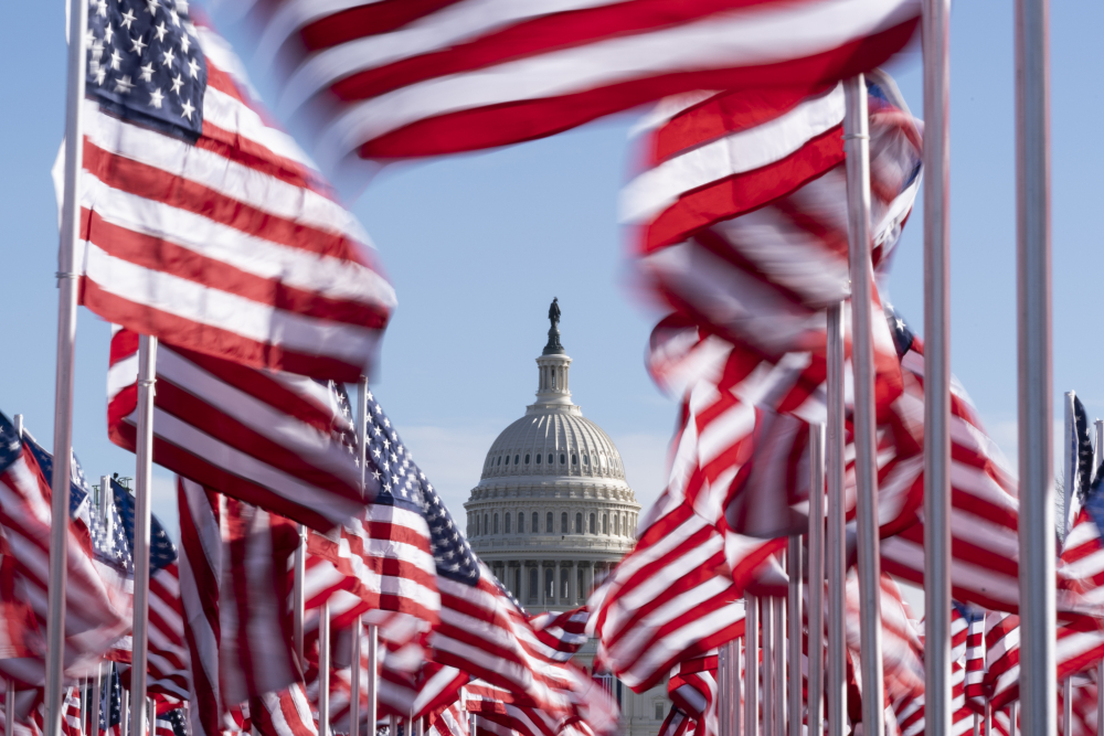 The U.S. Capitol is seen between flags placed on the National Mall ahead of the inauguration of President-elect Joe Biden and Vice President-elect Kamala Harris, Monday, Jan. 18, in Washington.