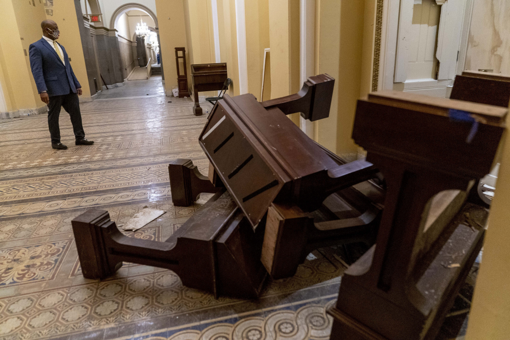 The U.S. Capitol was damaged in the Jan. 6 riot. A laptop is believed to have been stolen from the office of House Speaker Nancy Pelosi by a rioter. Here, Sen. Tim Scott, R-S.C., surveys the damage on Jan. 7.