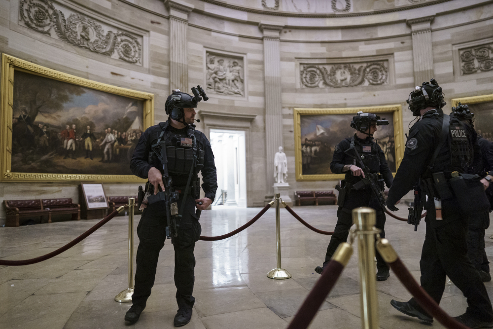 Members of the U.S. Secret Service Counter Assault Team walk through the Rotunda as they and other federal police forces responded as violent protesters loyal to President Donald Trump stormed the U.S. Capitol Wednesday.