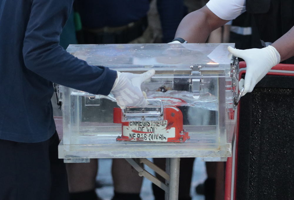 Members of the National Transportation Safety Committee carry a box containing the flight data recorder from the Sriwijaya Air flight SJ-182 retrieved from the Java Sea on Tuesday. Officials hope it'll reveal why the jet crashed shortly after take off on Saturday.
